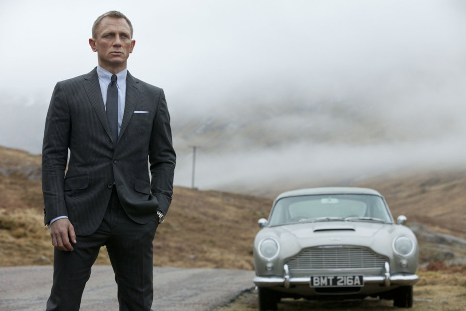 Photo - Daniel Craig as James Bond, seen with 007's beloved silver birch Aston-Martin DB5 in the action thriller