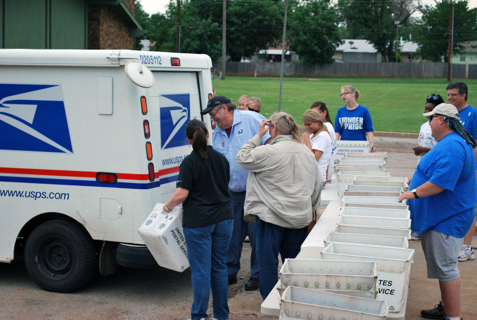 Photo - Volunteers sort through donated food during a previous Feeding Hope and Letter Carriers Food Drive. Postal workers will be collecting donated food  on May 11 for distribution to the Regional Food Bank.    PROVIDED - PROVIDED