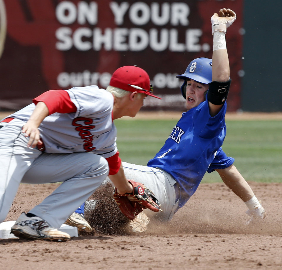 Photo - Claremore's Cole Weiesnbach tags Alex Forget at second after what appeared to be a fly out to short left field in the Class 5A baseball semifinal between Deer Creek and Claremore in school state championships at L. Dale Mitchell Park on May 16, 2014 in Norman, Okla. Photo by Steve Sisney, The Oklahoman