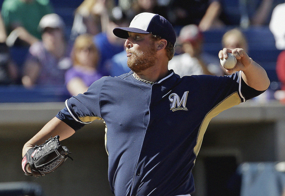 Photo - Milwaukee Brewers' Will Smith throws during the sixth inning of an exhibition spring training baseball game against the Chicago White Sox, Monday, March 10, 2014, in Phoenix. (AP Photo/Morry Gash)