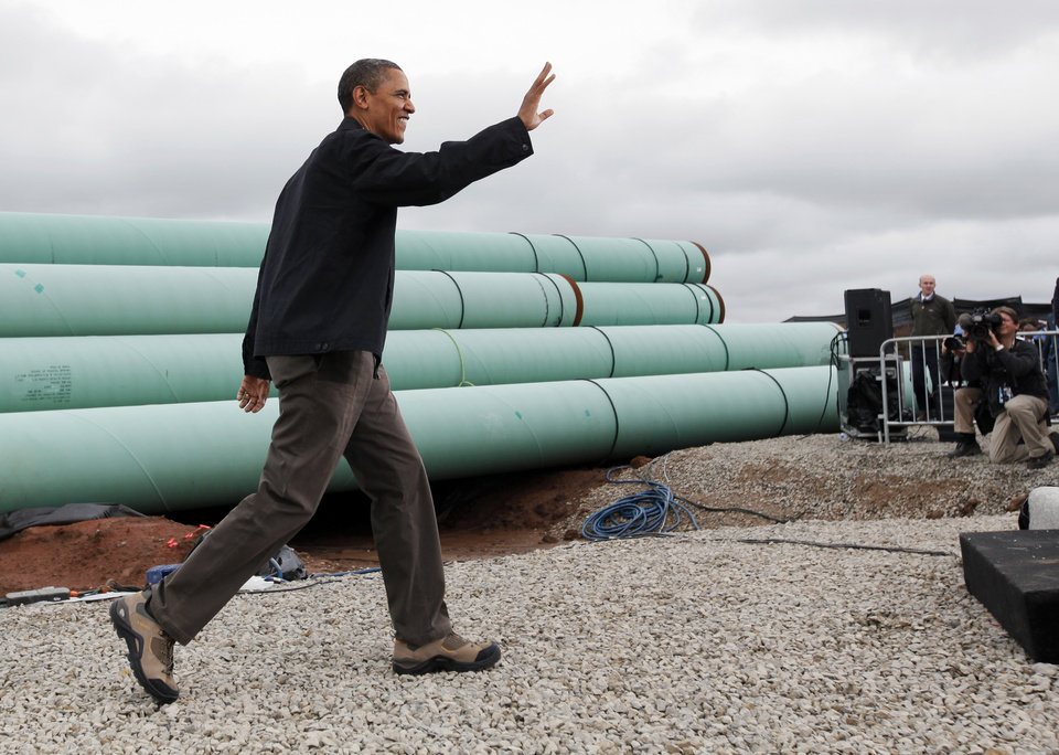 Photo - President Barack Obama waves to the crowd as he arrives at the TransCanada Pipe Yard near Cushing, Okla., Thursday, March 22, 2012. Photo by Nate Billings, The Oklahoman
