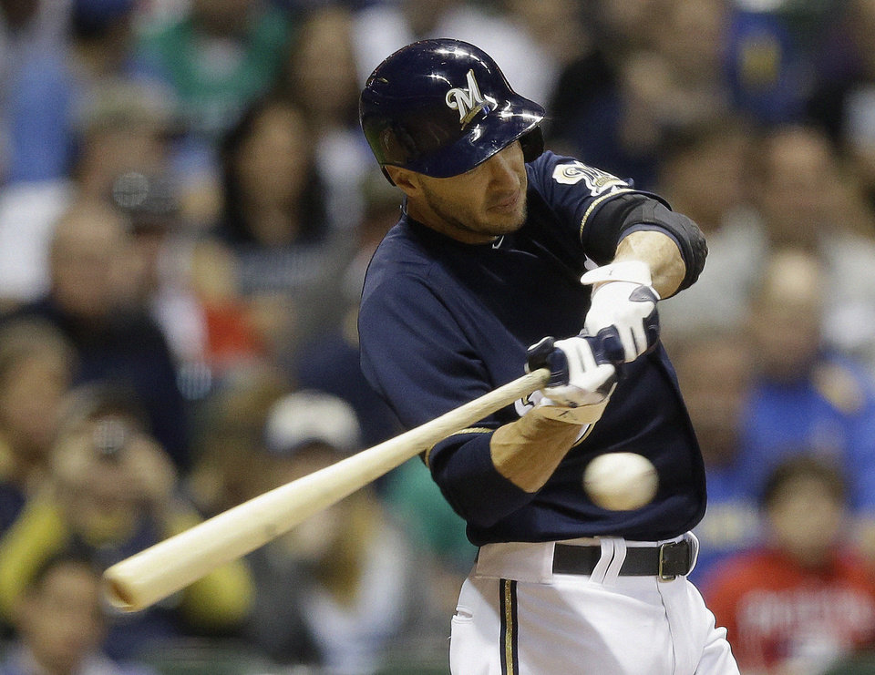 Photo - Milwaukee Brewers' Ryan Braun hits a triple during the sixth inning of a baseball game against the Texas Rangers, Wednesday, May 8, 2013, in Milwaukee. (AP Photo/Morry Gash)