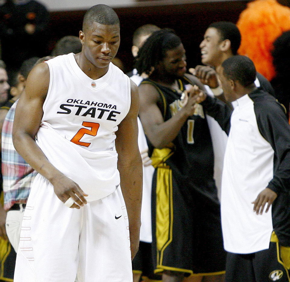 OSU\'s Obi Muonelo walks off the ourt after OSU\'s loss in the Big 12 college basketball game between Oklahoma State and Missouri at Gallagher-Iba Arena in Stillwater, Okla., Wednesday, Jan. 21, 2009. PHOTO BY BRYAN TERRY, THE OKLAHOMAN