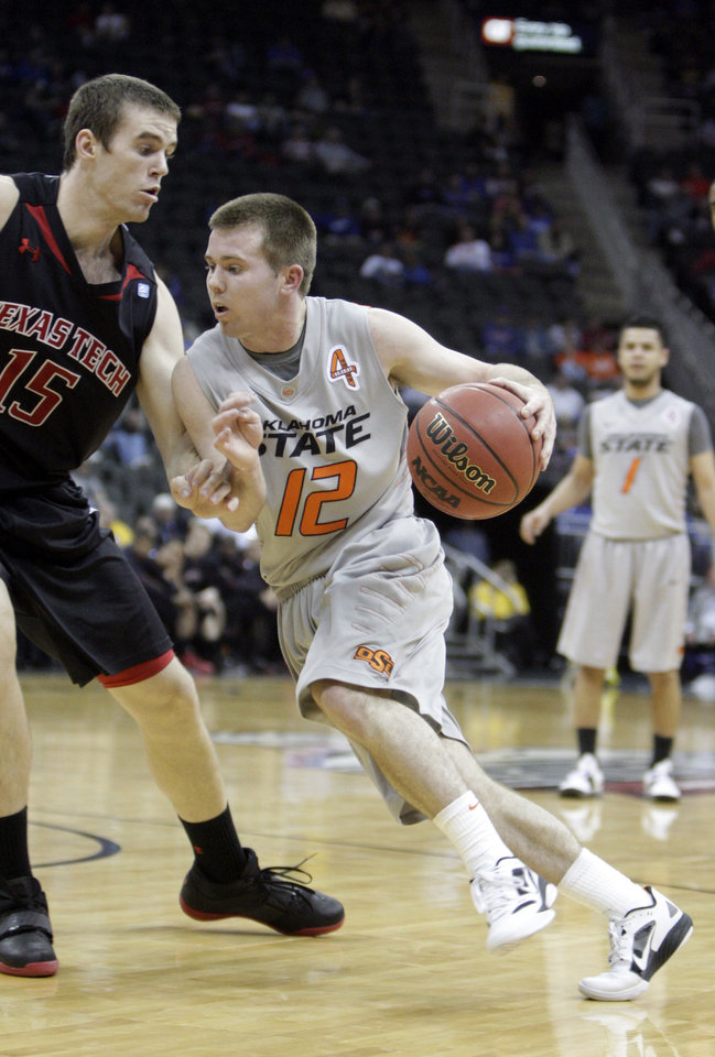 Photo - Oklahoma State's Keiton Page (12) drives past Texas Tech's Robert Lewandowski (15) during the Big 12 tournament men's basketball game between the Oklahoma State Cowboys and the Texas Tech Red Raiders at the Sprint Center, Wednesday, March, 7, 2012. Photo by Sarah Phipps, The Oklahoman