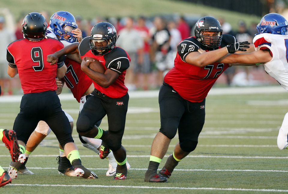 Photo - Jaguar Kieron Hardrtick takes off on a touchdown run in the first half as Westmoore plays Moore High School on Friday, Sept. 6, 2013 in Moore, Okla.  Photo by Steve Sisney, The Oklahoman