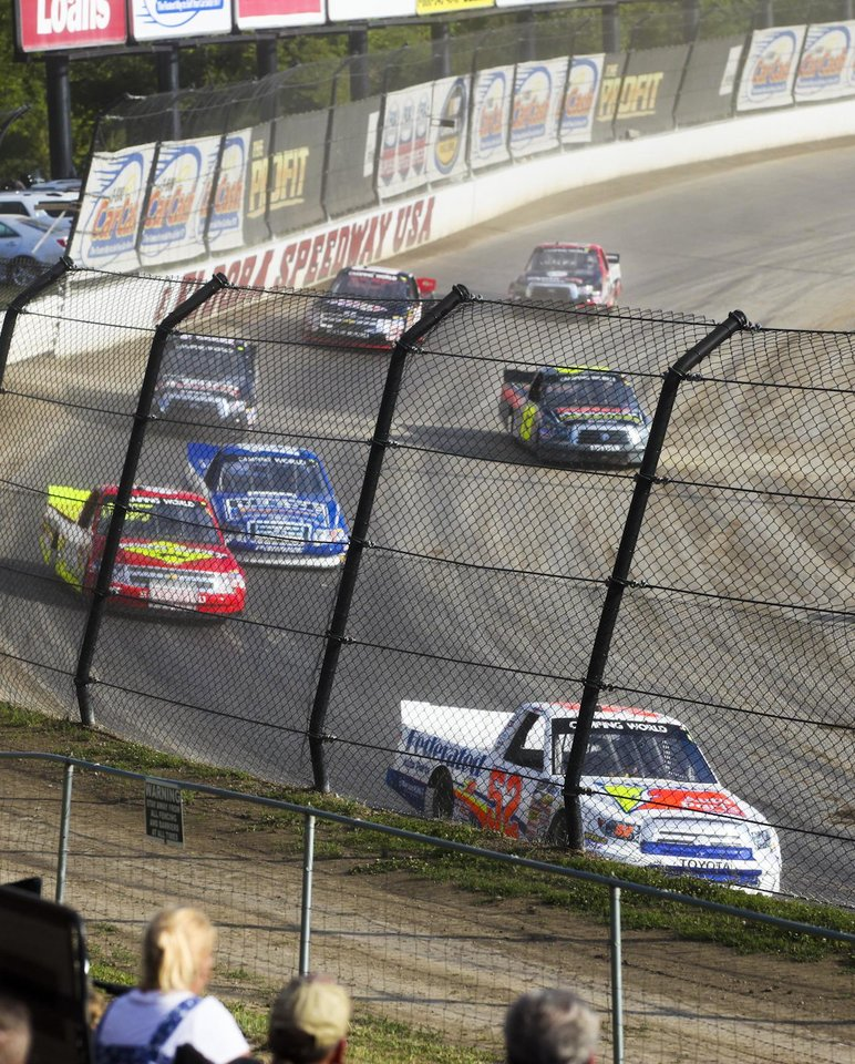 Photo - Drivers compete in a qualifying race for the NASCAR Truck Series auto race at Eldora Speedway, Wednesday, July 24, 2013, in Rossburg, Ohio. (AP Photo/Dayton Daily News, Greg Lynch) LOCAL PRINT OUT AND LOCAL TV OUT (WKEF, WRGT, WDTN)