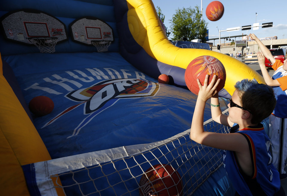 Photo - Bryton Wedemyer, 9, of Norman, Okla., shoot baskets at Thunder Alley before Game 2 in the second round of the NBA playoffs between the Oklahoma City Thunder and the Memphis Grizzlies at Chesapeake Energy Arena in Oklahoma City, Tuesday, May 7, 2013. Photo by Sarah Phipps, The Oklahoman