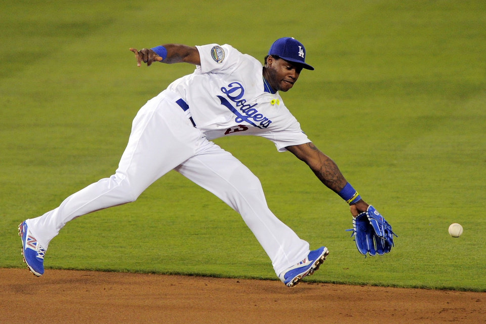 Photo -   Los Angeles Dodgers shortstop Hanley Ramirez cannot reach a ball hit for a single by St. Louis Cardinals' Yadier Molina during the second inning of their baseball game, Thursday, Sept. 13, 2012, in Los Angeles. (AP Photo/Mark J. Terrill)