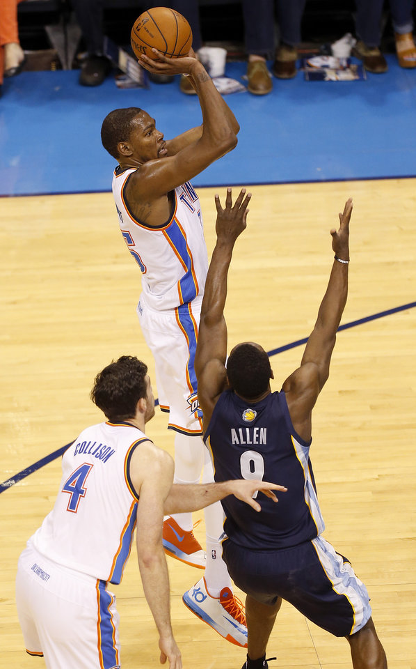 Photo - Oklahoma City's Kevin Durant (35) shoots over Memphis' Tony Allen (9) during Game 1 in the first round of the NBA playoffs between the Oklahoma City Thunder and the Memphis Grizzlies at Chesapeake Energy Arena in Oklahoma City, Saturday, April 19, 2014. Photo by Nate Billings, The Oklahoman