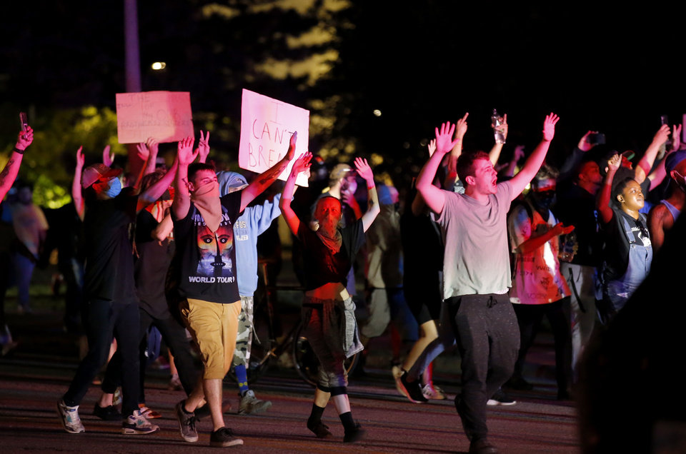 Photo - Protesters march during a protest near the intersection of 23rd and Classen in Oklahoma City, Saturday, May 30, 2020. The protest was in response to the death of George Floyd. [Sarah Phipps/The Oklahoman]