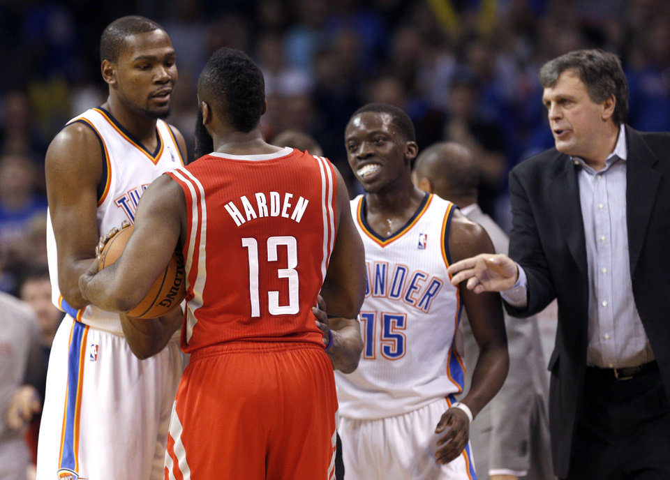 Photo - Oklahoma City's Kevin Durant (35) talks with Houston's James Harden (13) after a shoving match with Oklahoma City's Reggie Jackson (15) during the NBA game between the Oklahoma City Thunder and Houston Rockets at the  Chesapeake Energy Arena  in Oklahoma City, Okla., Tuesday, March 11, 2014. Photo by Sarah Phipps, The Oklahoman
