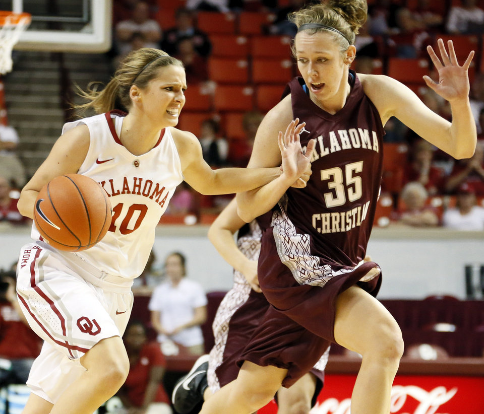 OU's Morgan Hook (10) drives past Roz Hamilton (35) of Oklahoma Christian during a women's college basketball exhibition game between the University of Oklahoma and Oklahoma Christian University at the Lloyd Noble Center in Norman, Okla., Thursday, Nov. 1, 2012. Photo by Nate Billings, The Oklahoman