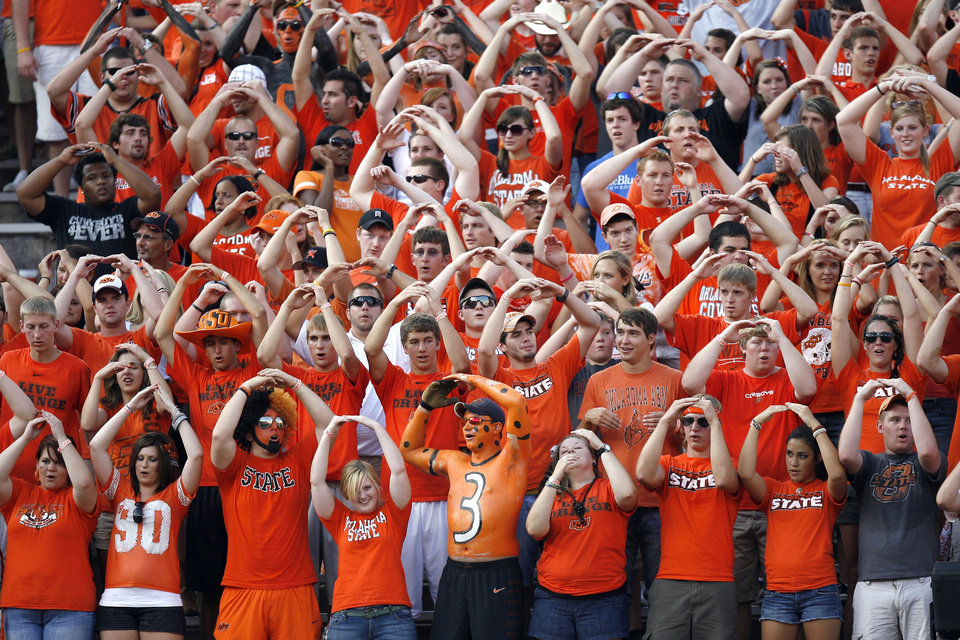 OSU fans cheer during the college football game between the University of Tulsa (TU) and Oklahoma State University (OSU) at Boone Pickens Stadium in Stillwater, Oklahoma, Saturday, September 18, 2010. Photo by Sarah Phipps, The Oklahoman