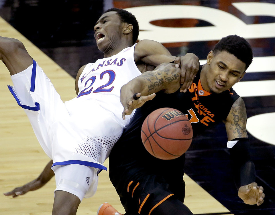 Photo - Kansas' Andrew Wiggins (22) and Oklahoma State's Le'Bryan Nash battle for a rebound during the second half of an NCAA college basketball game in the Big 12 men's tournament on Thursday, March 13, 2014, in Kansas City, Mo. (AP Photo/Charlie Riedel)