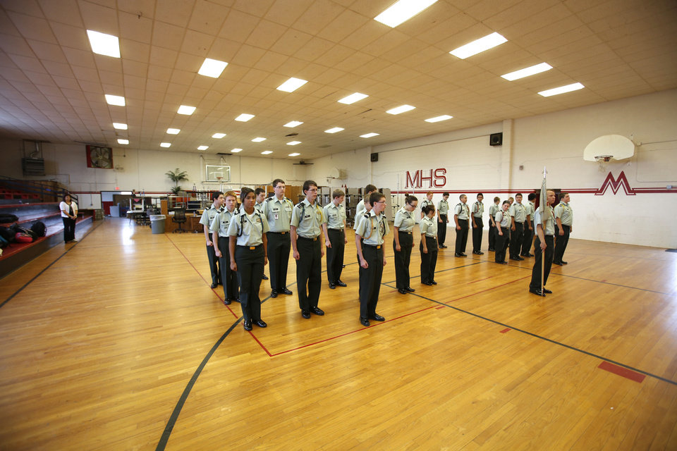 Members of the ROTC stand in formation in the old gymnasium at Mustang High School.  Photos By Steve Gooch, The Oklahoman