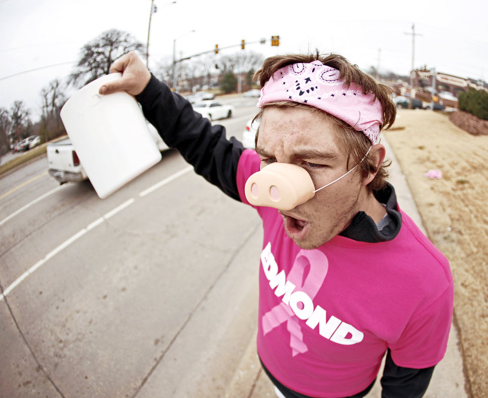 Photo - Edmond Memorial sophomore Will King, 16, stands at 15th Street and Bryant to raise money for Swine Week. Funds raised went to The Jimmy Everest Center for Cancer and Blood Disorders in Children.  PHOTO BY BRYAN TERRY, OKLAHOMAN ARCHIVE