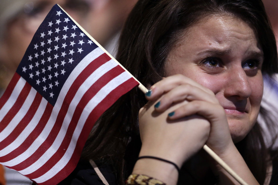 Photo -   A supporter cries as President Barack Obama speaks during an election night party, Wednesday, Nov. 7, 2012, in Chicago. Obama defeated Republican challenger former Massachusetts Gov. Mitt Romney. (AP Photo/Matt Rourke)