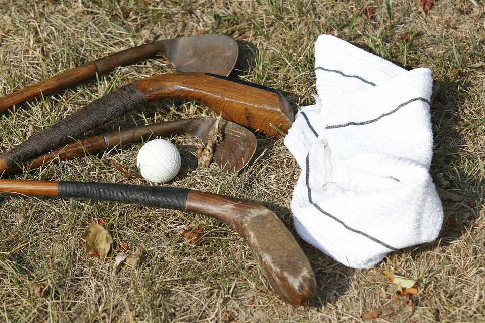 FILE - In this Saturday July 30, 2011 file photo shows old wooden clubs a towel and PH Gutta Percha golf ball is displayed at the Oakhurst links golf course in White Sulphur Springs, WV., Greenbrier owner Jim Justice told The Associated Press on Friday, Oct. 12, 2012, he is taking over Oakhurst Links, a few miles north of the resort in White Sulphur Springs. (AP Photo/Steve Helber)