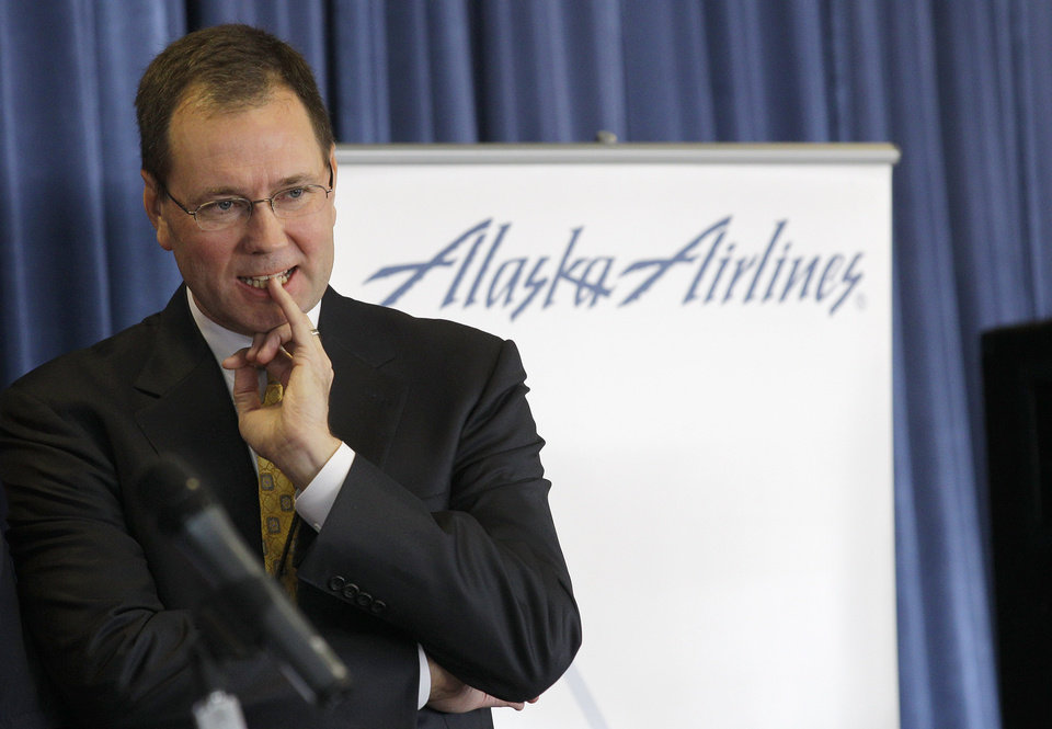 Alaska Airlines President and CEO Brad Tilden listens to a question from a reporter Monday, Oct. 8, 2012, during a press event at Seattle-Tacoma International Airport in Seattle unrelated to the system-wide outage of the computers the airline uses to check in passengers that was going on at the same time. Some Alaska Airlines flights were able to be checked in manually, but most flights were delayed or canceled. (AP Photo/Ted S. Warren)
