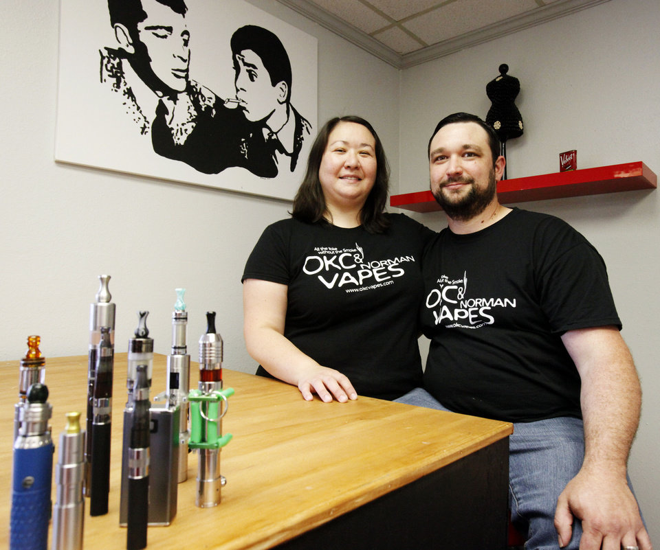 Stephanie and John Durst pose with some of their more elaborate e-cigarette products in the OKC Vapes store located on 3710 NW 50th St. in Oklahoma City. Photo by Aliki Dyer,  The Oklahoman <strong>Aliki Dyer - The Oklahoman</strong>