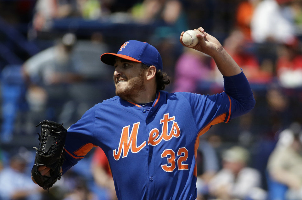 Photo - New York Mets pitcher John Lannan throws in the first inning of an exhibition spring training baseball game against the St. Louis Cardinals, Wednesday, March 12, 2014, in Port St. Lucie, Fla. (AP Photo/David Goldman)