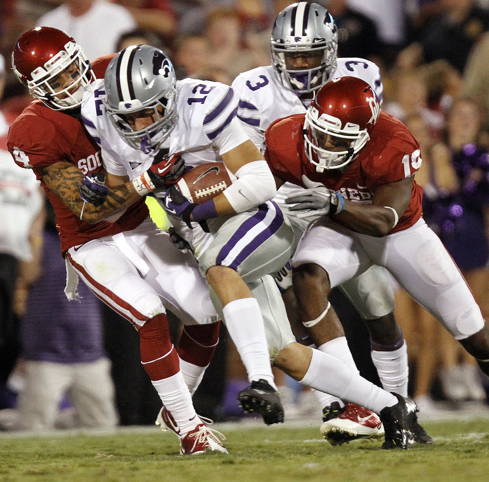 Photo - Oklahoma's Kenny Stills (4) and Justin Brown (19) bring down Kansas State's Ty Zimmerman (12) after an interception during the college football game between the University of Oklahoma Sooners (OU) and the Kansas State University Wildcats (KSU) at the Gaylord Family-Memorial Stadium on Saturday, Sept. 22, 2012, in Norman, Okla. Photo by Chris Landsberger, The Oklahoman