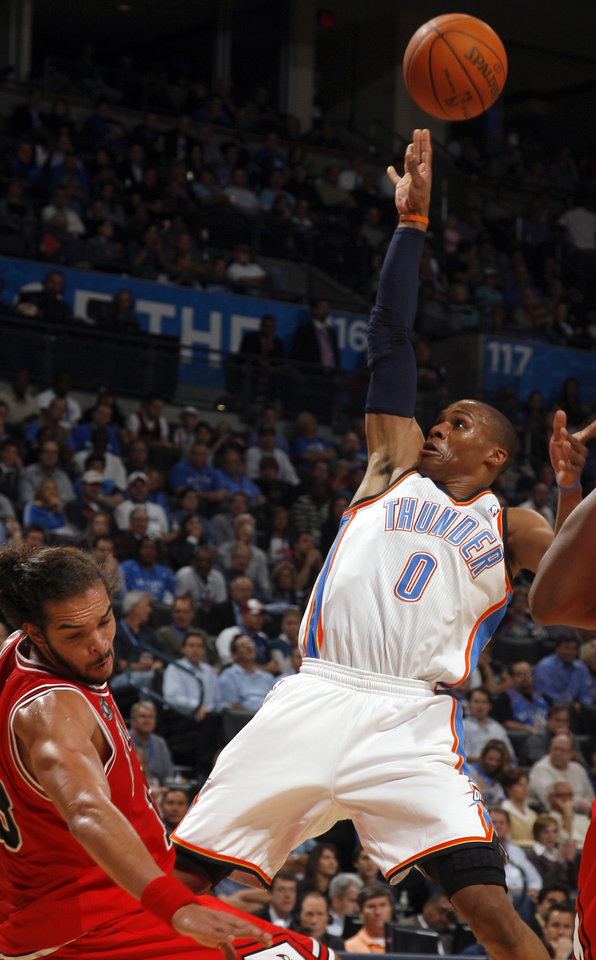 Photo - Oklahoma City's Russell Westbrook shoots over Chicago's Joakim Noah during the NBA season opener basketball game between the Oklahoma City Thunder and the Chicago Bulls in the Oklahoma City Arena on Wednesday, Oct. 27, 2010. Photo by Sarah Phipps, The Oklahoman