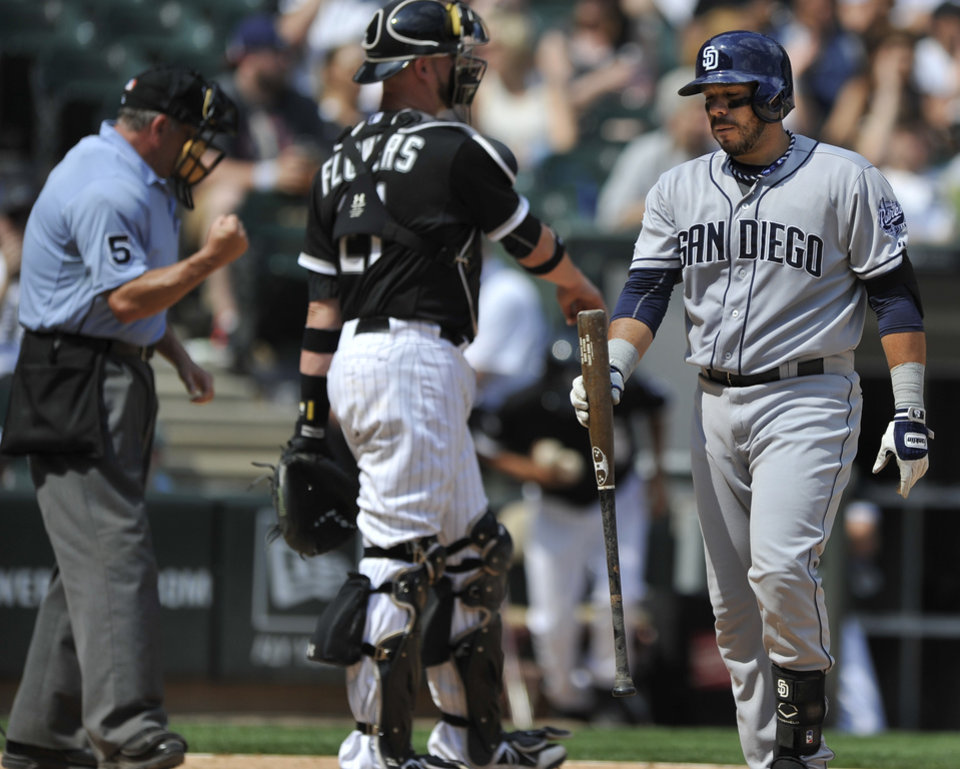 Photo - San Diego Padres' Rene Rivera, right,  reacts to striking out during the ninth inning of an inter league baseball game against the Chicago White Sox in Chicago, Sunday, June 1, 2014. Chicago won 4-1. (AP Photo/Paul Beaty)