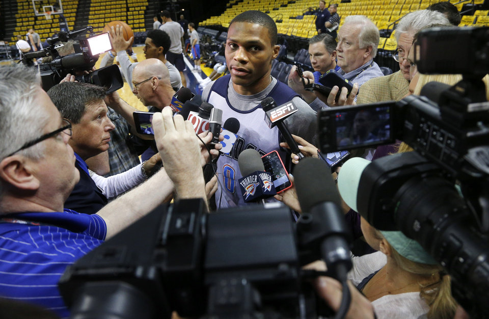 Photo - Oklahoma City's Russell Westbrook talks with reporters during a shootaround before Game 6 in the first round of the NBA playoffs between the Oklahoma City Thunder and the Memphis Grizzlies at FedExForum in Memphis, Tenn., Thursday, May 1, 2014. Photo by Bryan Terry, The Oklahoman