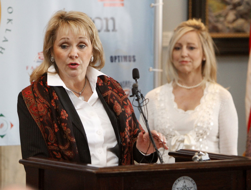Photo - Gov. Mary Fallin on Monday announces the results of the third annual Feeding Oklahoma Food and Fund Drive. The drive exceed its goal by raising $359,611 and 823,278 pounds of food. That equates to 2.6 million meals, the governor's office reported. The goal of the drive was to generate 1.2 million meals. PHOTO BY PAUL HELLSTERN, THE OKLAHOMAN  PAUL HELLSTERN