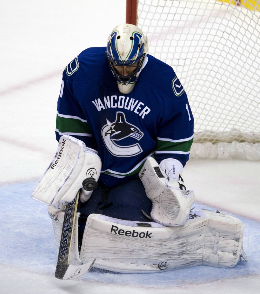 Photo - Vancouver Canucks goalie Roberto Luongo (1) makes a save during the first period of an NHL hockey game against the Minnesota Wild, Tuesday, Feb. 12, 2013, in Vancouver, British Columbia. (AP Photo/The Canadian Press, Jonathan Hayward)