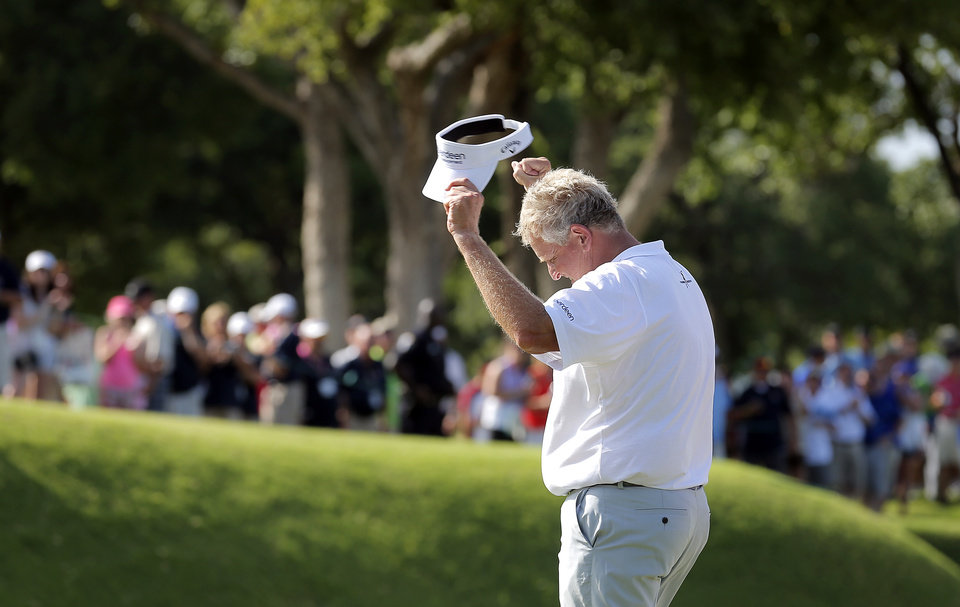 Colin Montgomerie celebrates his putt on the 18th hole during a 3-hole playoff in the final round of the U.S. Senior Open golf tournament at Oak Tree National in Edmond, Okla., Sunday, July 13, 2014. Photo by Sarah Phipps, The Oklahoman