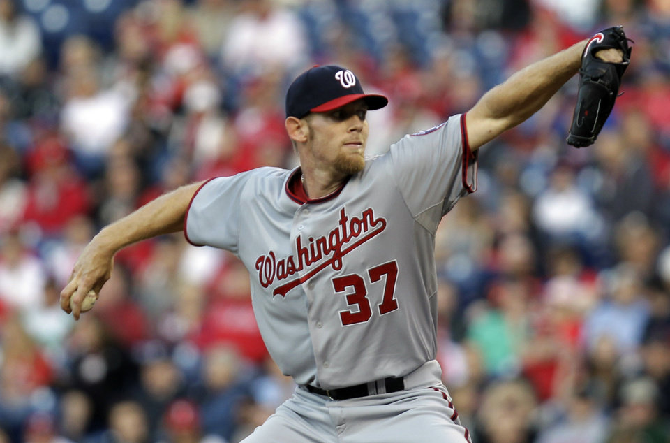 Photo - Washington Nationals pitcher Stephen Strasburg throws in the first inning of a baseball game against 2the Philadelphia Phillies, Friday, May 2, 2014, in Philadelphia. (AP Photo/Laurence Kesterson)