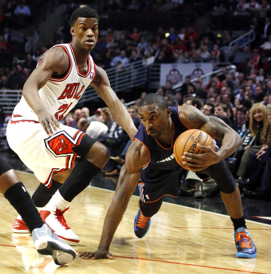 Charlotte Bobcats guard Ben Gordon, right, maintains his balance as Chicago Bulls forward Jimmy Butler defends during the first half of an NBA basketball game, Monday, Jan. 28, 2013, in Chicago. (AP Photo/Charles Rex Arbogast)