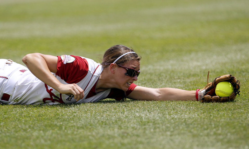 Photo - COLLEGE SOFTBALL: University of Alabama's Kayla Braud (1) dives for a catch during the Women's College World Series game between Alabama and California at the ASA Hall of Fame Stadium in Oklahoma City, Thursday, June 2, 2011. Photo by Sarah Phipps, The Oklahoman ORG XMIT: KOD