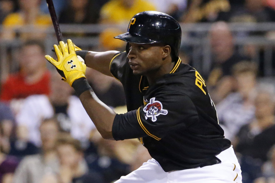 Photo - Pittsburgh Pirates' Gregory Polanco drives in a run with a single off Cincinnati Reds starting pitcher Alfredo Simon during the fifth inning of a baseball game in Pittsburgh Wednesday, June 18, 2014. The hit extends Polanco's hitting streak to eight games to begin his major league career, one more than Pirates Hall of Famer Roberto Clemente, who had a seven game hitting streak to begin his major league career in 1954. (AP Photo/Gene J. Puskar)