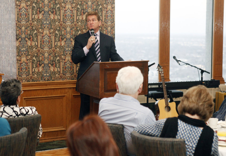 """Photo - Joe Theismann, former NFL star quarterback, speaks at the Bill Glass """"Breakfast of Champions"""" Friday at the Petroleum Club in downtown Oklahoma City.  Photo by PAUL HELLSTERN, Oklahoman"""