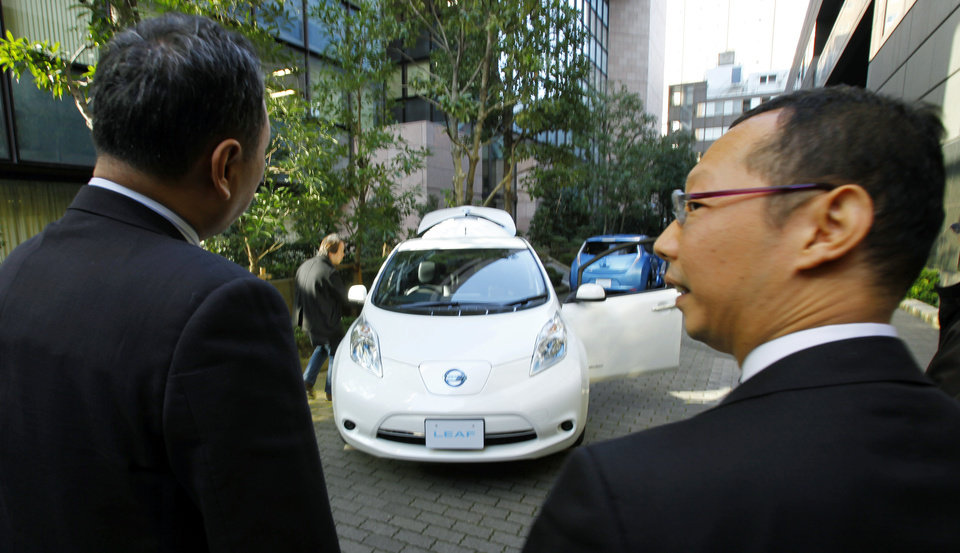 Nissan Motor Co.\'s latest LEAF electric car is displayed for media in Tokyo, Tuesday, Nov. 20, 2012. The upgraded Leaf electric car from Nissan can travel further without recharging, comes in a cheaper model and tells drivers how much battery life is left. (AP Photo/Junji Kurokawa)
