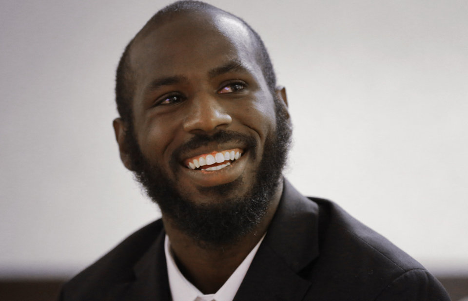 Photo - FILe - In this July 23, 2014, file photo, Marshall quarterback Rakeem Cato smiles during an interview during the NCAA college Conference USA football media day in Irving, Texas. Cato enters his senior season with the chance to become the most prolific quarterback in school history. (AP Photo/File)