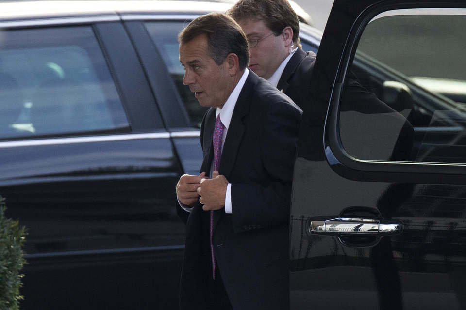 Photo - House Speaker John Boehner of Ohio arrives at the White House in Washington, Friday, Dec. 28, 2012, for a meeting between President Barack Obama and Congressional leaders to negotiate the framework for a deal on the fiscal cliff.  The negotiations are a last ditch effort to avoid across-the-board first of the year tax increases and deep spending cuts.  (AP Photo/ Evan Vucci)