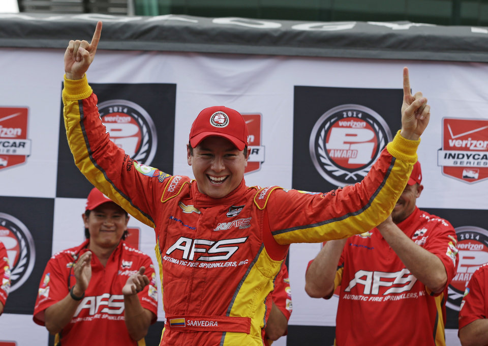 Photo - Sebastian Saavedra, of Colombia,  celebrates after winning the pole for the inaugural Grand Prix of Indianapolis IndyCar auto race at the Indianapolis Motor Speedway in Indianapolis, Friday, May 9, 2014. (AP Photo/Darron Cummings)