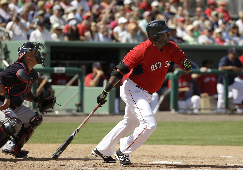 Photo - Boston Red Sox designated hitter David Ortiz, right, watches the flight of his double, in front of Atlanta Braves catcher Gerald Laird during the fourth inning of an exhibition baseball game Friday, March 7, 2014, in Fort, Myers, Fla. The Red Sox won 4-1. (AP Photo/Steven Senne)
