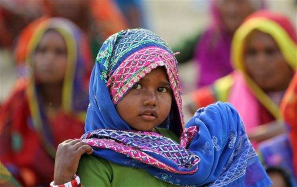 Photo - An Indian child attends an event to support the