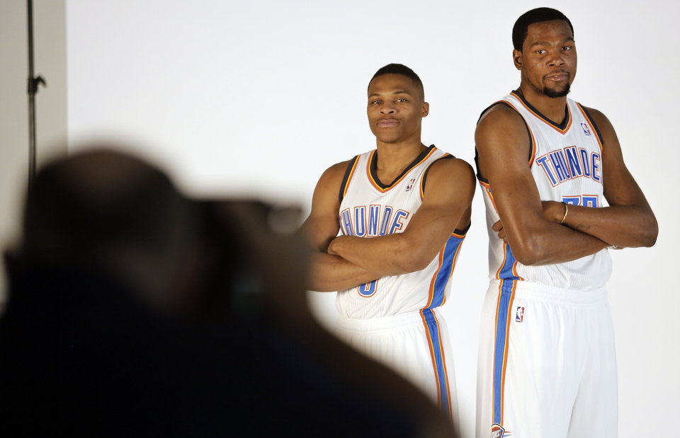 Photo - Russell Westbrook and Kevin Durant pose for photos during media day with the Oklahoma City Thunder in Oklahoma City, Thursday September  27, 2013. Photo By Steve Gooch, The Oklahoman