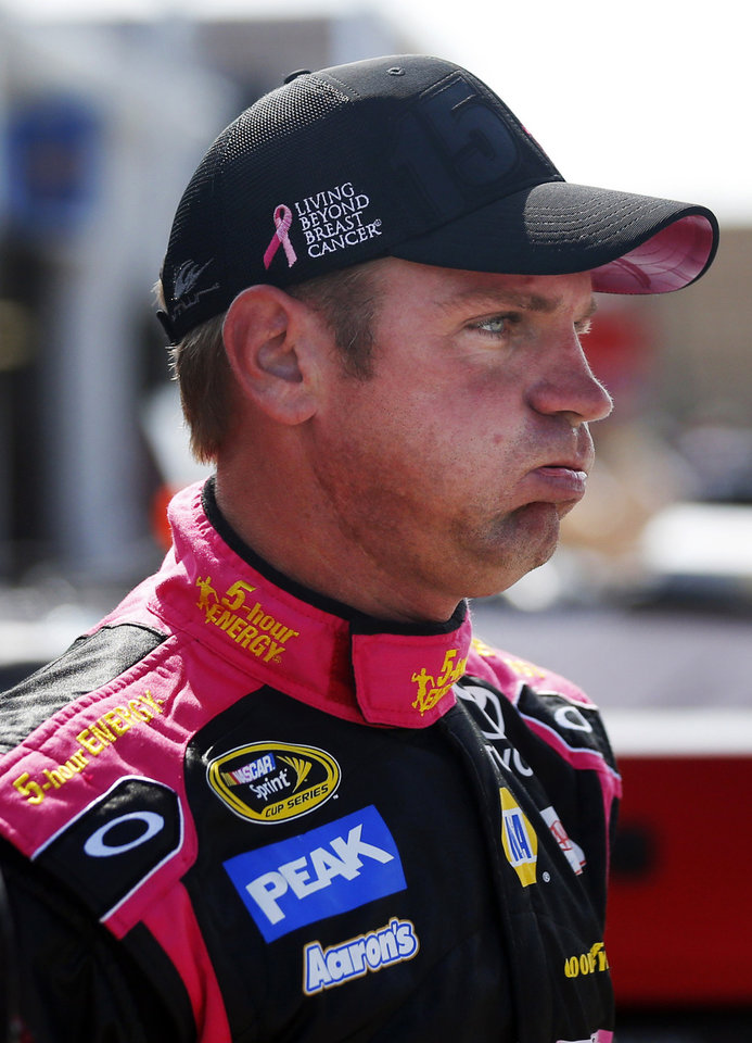 Photo - Driver Clint Bowyer exhales following practice for Sunday's NASCAR Sprint Cup series auto race at Kansas Speedway in Kansas City, Kan., Friday, Oct. 4, 2013. (AP Photo/Orlin Wagner)