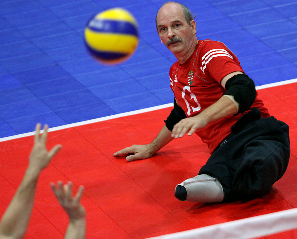 Hungary's Gyorgy Dominek plays against Brazil during the fourth day of competition at the World Sitting Volleyball championships on the University of Central Oklahoma campus in Edmond, Okla., on Wednesday, July 14, 2010. Photo by John Clanton, The Oklahoman