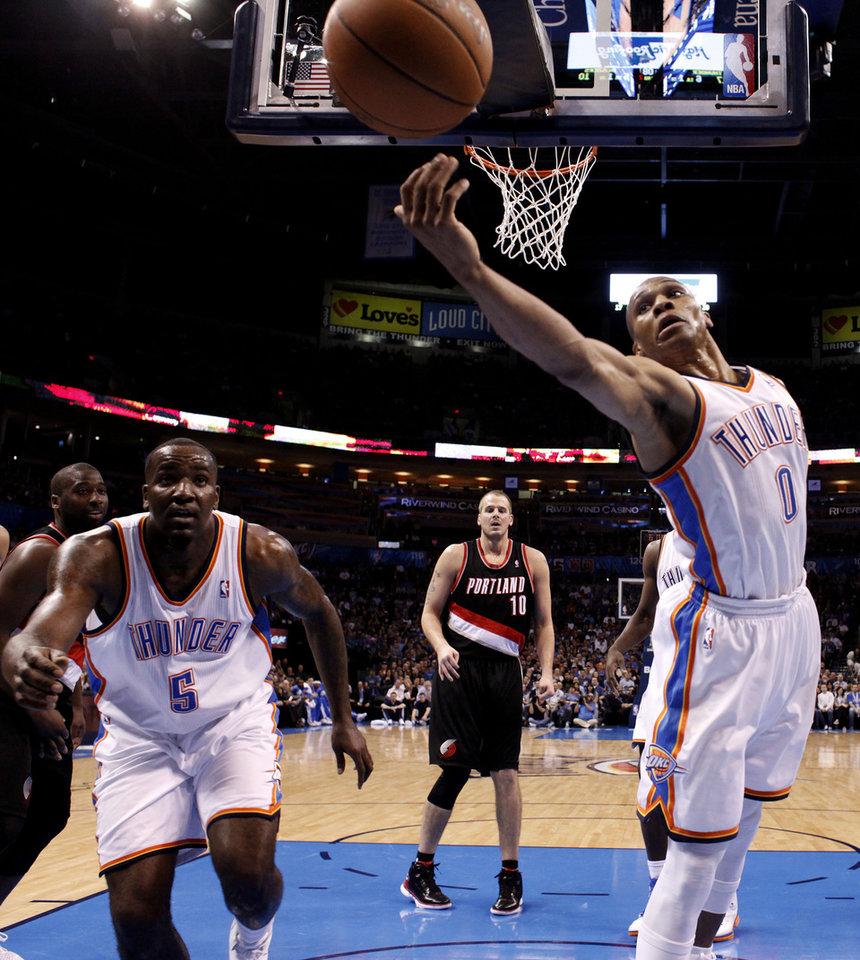Oklahoma City's Russell Westbrook (0) tries to rebound a ball as Kendrick Perkins (5) looks on during the NBA basketball game between the Oklahoma City Thunder and the Portland Trail Blazers at Chesapeake Energy Arena in Oklahoma City, Sunday, March 18, 2012. Photo by Sarah Phipps, The Oklahoman.
