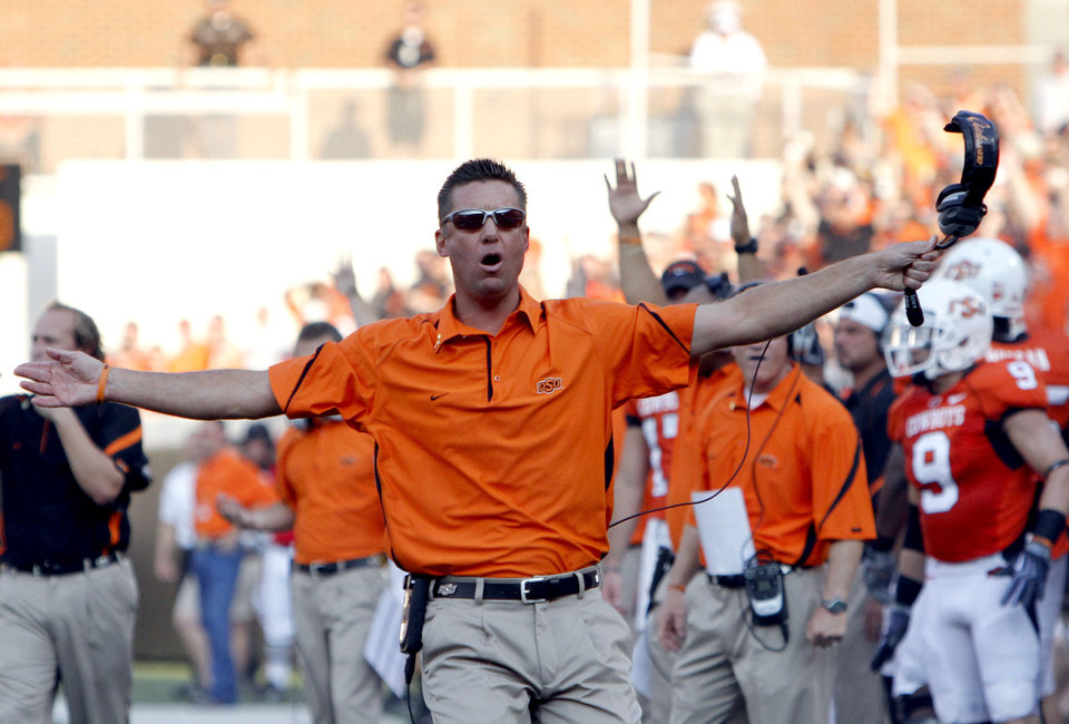 Photo - Oklahoma State head coach Mike Gundy argues a call during the college football game between the University of Tulsa (TU) and Oklahoma State University (OSU) at Boone Pickens Stadium in Stillwater, Oklahoma, Saturday, September 18, 2010. Photo by Sarah Phipps, The Oklahoman