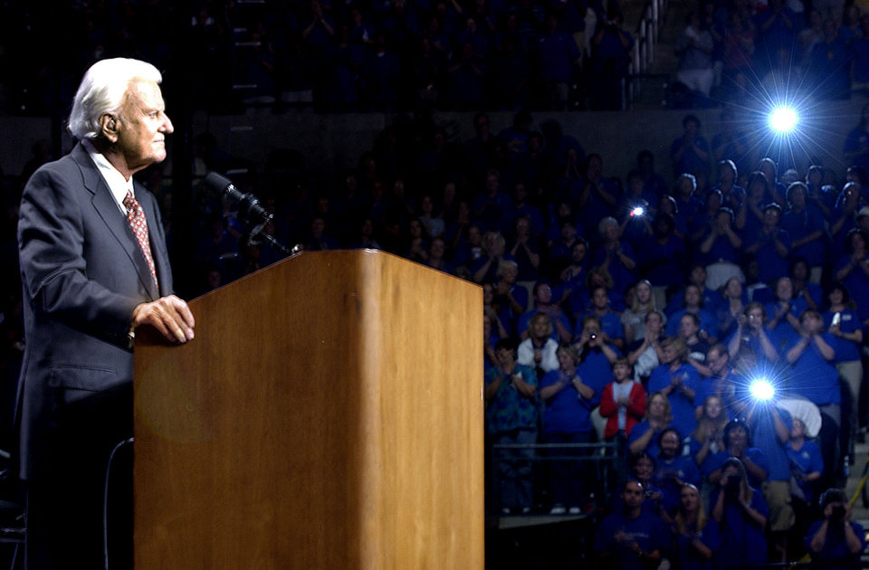 Photo - Oklahoma City, Sun., June 15, 2003. Flashes go off in the crowd as Billy Graham takes the stage during the last day of Mission Oklahoma City with the Rev. Billy Graham at the Ford Center.   Staff photo by Bryan Terry
