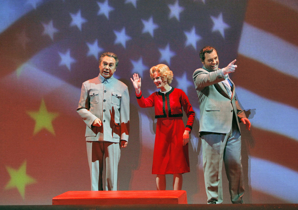 Photo -   In this June 5, 2012 handout photo provided by the San Francisco Opera, Chen-Ye Yuan, as Chou En-lai, from left, Maria Kanyova, as Pat Nixon, and Brian Mulligan, as Richard Nixon, are shown during a scene from the final dress rehearsal of Nixon in China. The production, increasingly recognized as a modern masterpiece, is finally getting the recognition it deserves on the home ground of composer John Adams, in a sparkling production that highlights the San Francisco Opera's summer season. (AP Photo/San Francisco Opera, Cory Weaver, handout)